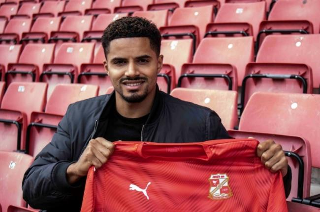 Former Manchester United player Zeki Fryers became Swindon Town's third summer signing earlier this week after penning a two-year contract