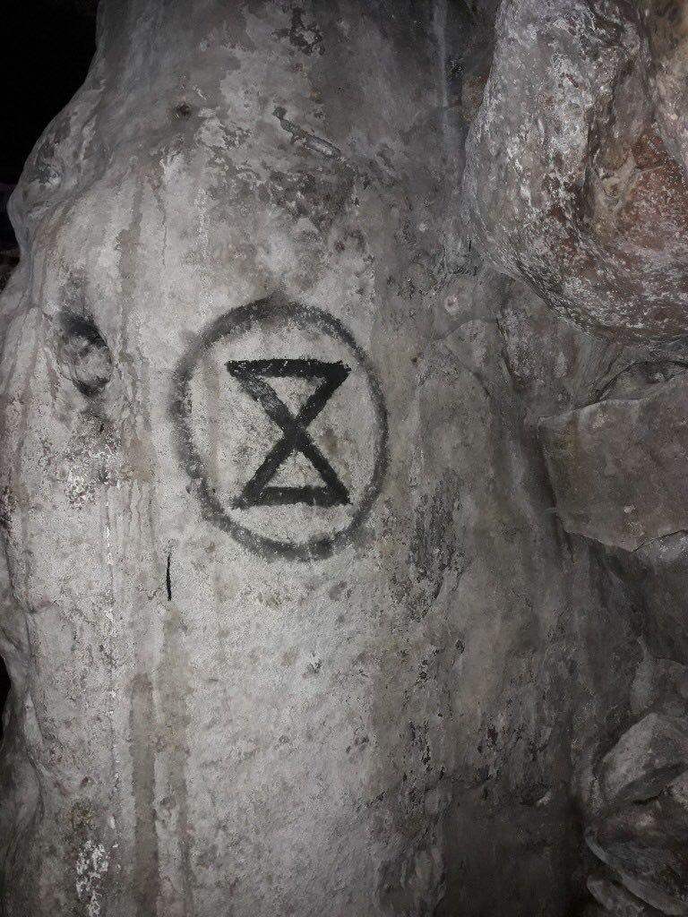 Swindon Extinction Rebellion condemn logo graffiti on West Kennet Long Barrow