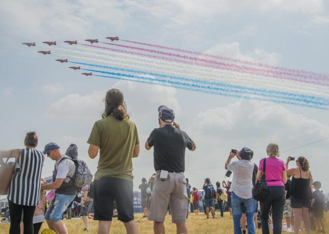 The Red Arrows fly over the crowd at a previous Royal International Air Tattoo. Picture: Thomas Kelsey.
