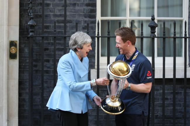 Eoin Morgan enjoys showing off England's World Cup trophy to Prime Minister Theresa May