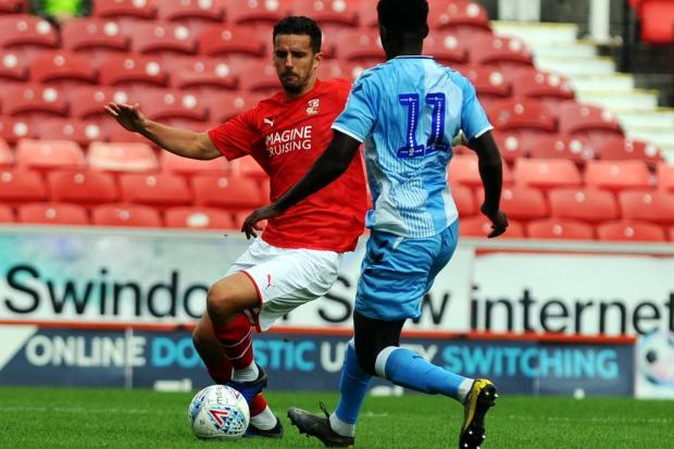 Mathieu Baudry in action for Swindon Town against Coventry City during pre-season ahead of the 2019-20 campaign