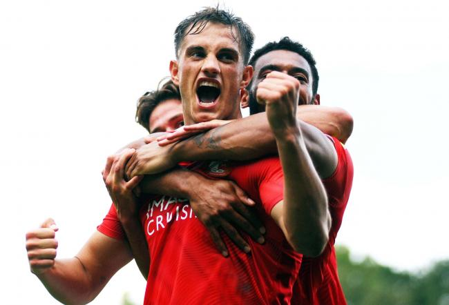 Jerry Yates celebrates his opening goal for Swindon Town at Scunthorpe United. PICTURE: DAVE EVANS