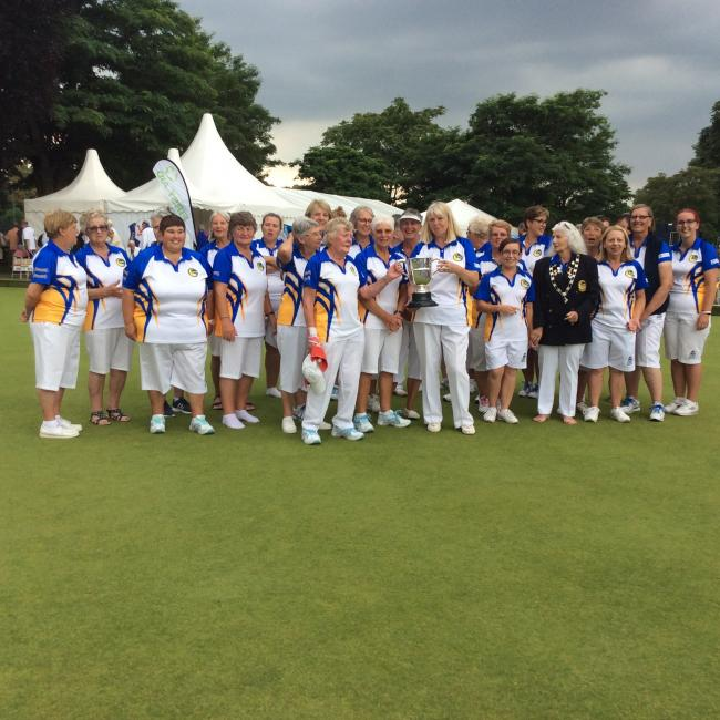 Wiltshire Ladies celebrate with John's Trophy runners-up award after their defeat to Surrey in the inter-county championship final