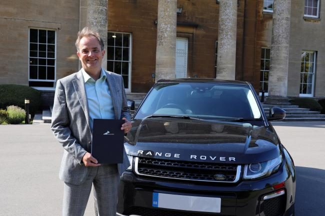James Monk, Director of International Trade Services at Business West is holding export documentation and is stood by a Range Rover similar to that caught up in the scam