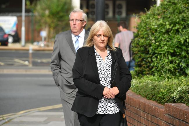 Sherry Bray, 48, and Christopher Ashford, 62, leave Swindon Magistrates' Court where they  where summonsed to appear over an image that allegedly showed the remains of footballer Emiliano Sala at the Holly Tree Lodge mortuary in Bournemouth. PRESS ASS