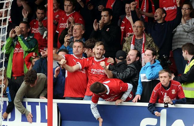 Happy supporters celebrate Swindon Town's victory over Carlisle United at the weekend