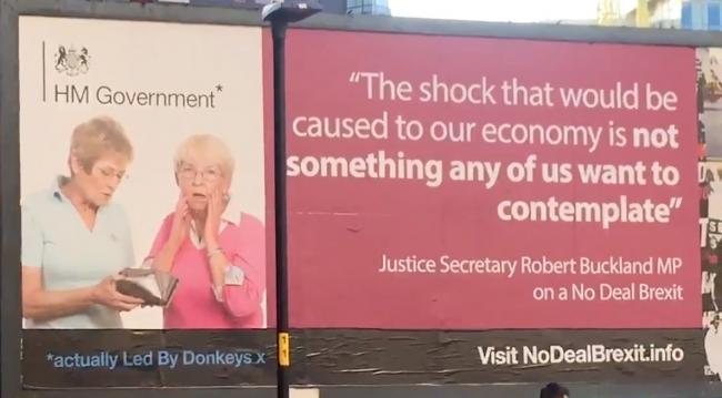 Led by Donkeys billboard in Manchester with a Robert Buckland MP quote