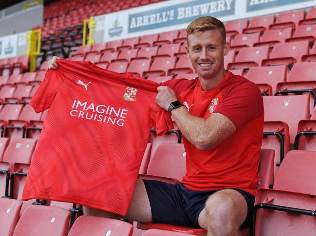 Eoin Doyle proudly displays his new Swindon Town shirt after signing for the club on loan. PICTURE: SWINDON TOWN FC