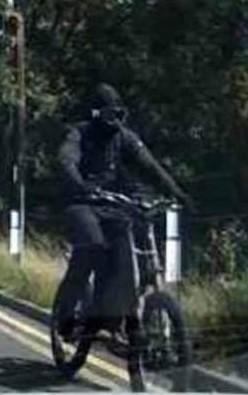 The balaclava-wearing thug who is said to have kicked a wing mirror in Blunsdon