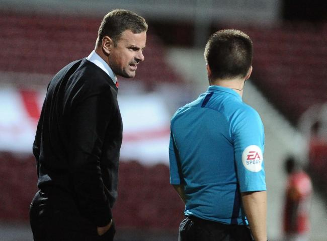 An unhappy Richie Wellens voices his frustration to Tuesday night's fourth official Picture: DAVE EVANS