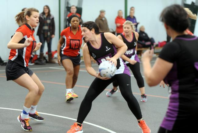 Raychem Netball Club in purple playing in 2016
