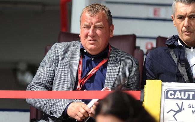 Swindon Town chairman Lee Power watches the club's League Two win at home to Morecambe on Saturday