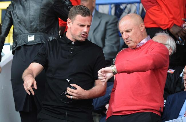 Richie Wellens, serving the second of a two-match touchline ban, pictured in the directors' box with Paul Jewell. PICTURE: DAVE EVANS