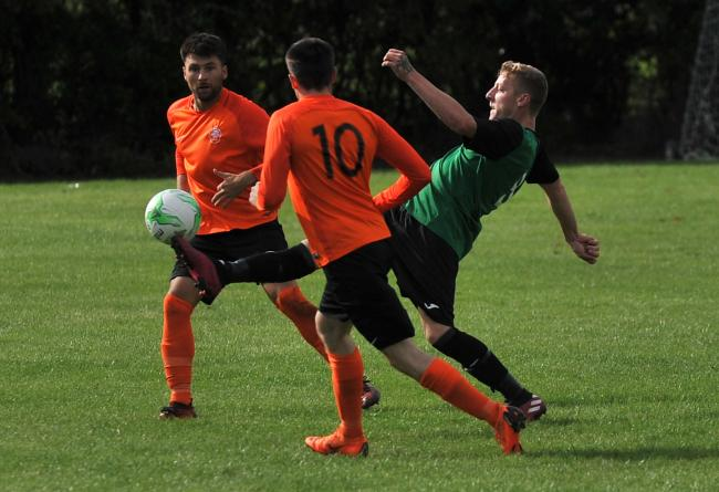 Action from Cricklade Town's (green) home game against Kintbury Rangers      Pic: DAVE COX