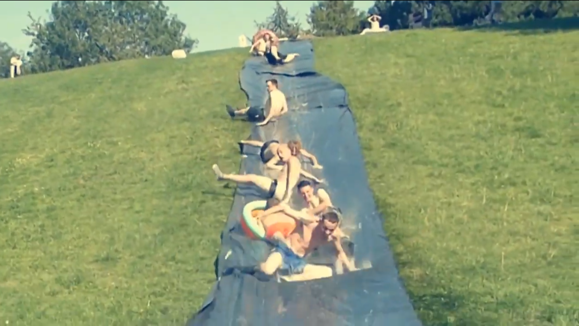 Trio create giant water slide down Coate Water Hill
