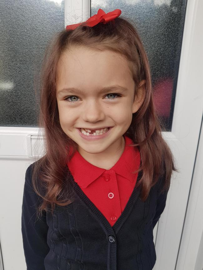 Gappy and happy! Beatrice Brown aged 6 heading into Year 2 at Moredon Primary School with 2 less teeth, a new haircut and full of excitement to see her friends.