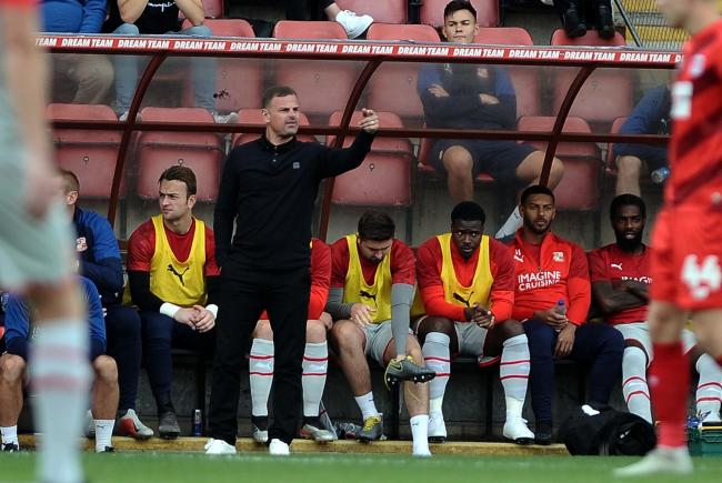 Swindon Town manager Richie Wellens points the way for this side from the dugout