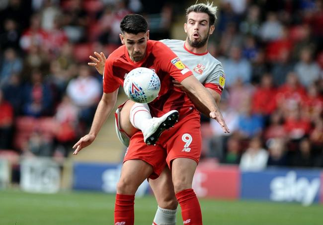 Dion Conroy duels with Leyton Orient striker Connor Wilkinson during Swindon Town's 3-1 win at Brisbane Road in League Two last weekend			Picture: DAVE EVANS
