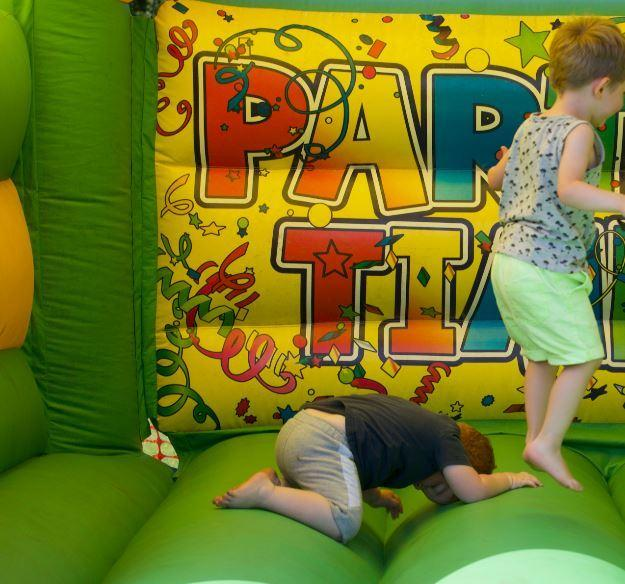 This is a file picture of children on a bouncy castle
