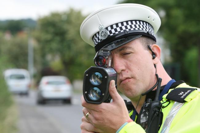 Stuart Harrison 20/8/12.Pc Phil Matthews from Wiltshire Police HQ Responce pictures using a speed camera on Swindon Road, Wroughton