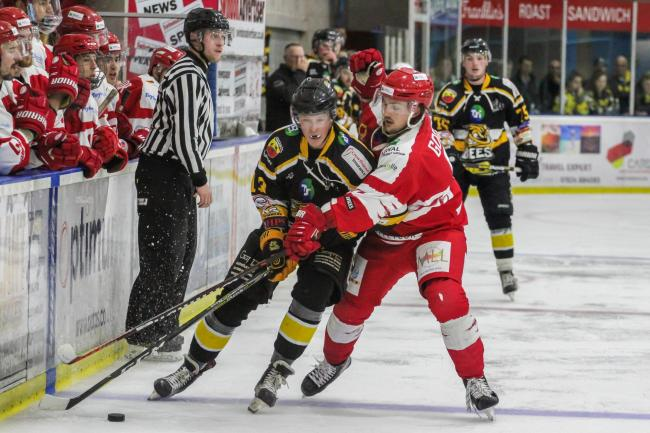 Swindon Wildcats' Sam Godfrey (red) battles for the puck against Bracknell Bees. PICTURE: KAT MEDCROFT