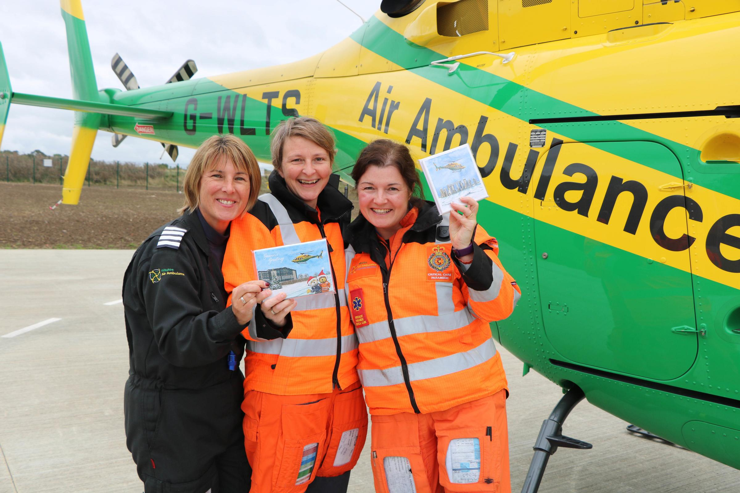 Snowy scenes of Stonehenge in Wiltshire Air Ambulance Christmas cards
