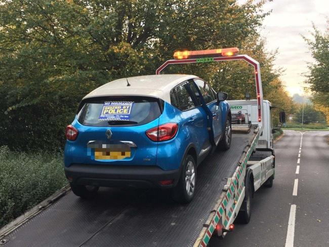 The car was seized and taken away by police Picture: SWINDON NORTH POLICE/FACEBOOK