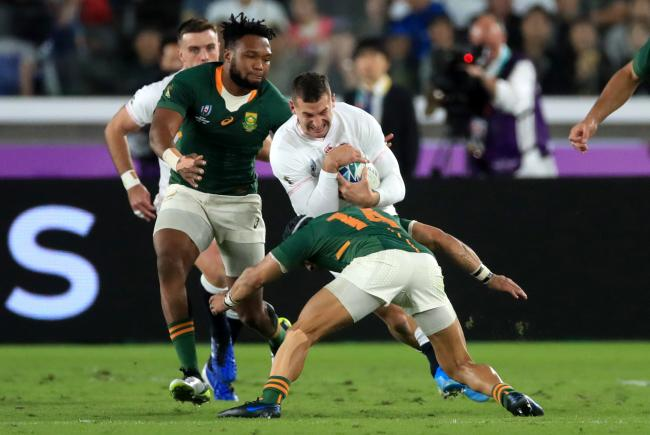 England's Jonny May is challenged by Australia's Cheslin Kolbe during the 2019 Rugby World Cup final match at Yokohama Stadium. PA Photo. Picture date: Saturday November 2, 2019, See PA story RUGBYU England. Photo credit should read: Adam Davy/PA