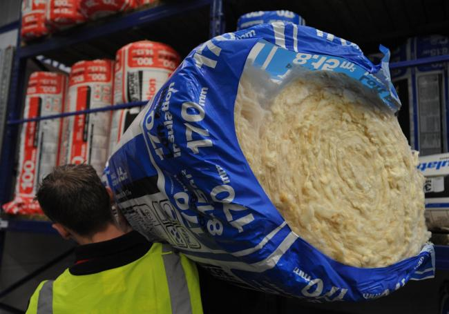 Loft insulation would be fitted in most of Swindon's 97,800 homes as part of Labour's scheme