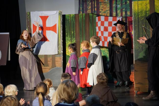 Children from St Margaret's perform Robin Hood.