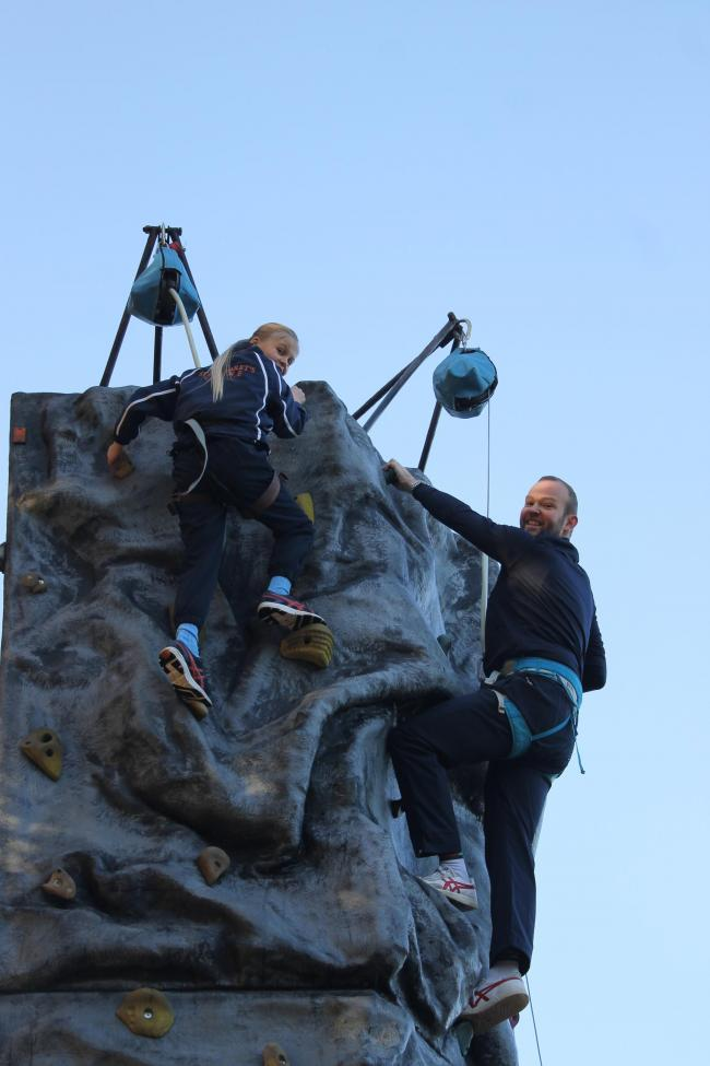 St Margaret's head Luke Bromwich takes part in a climbing wall challenge with pupils