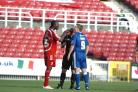 Kevin Amankwaah and Neil Harris clash on Saturday