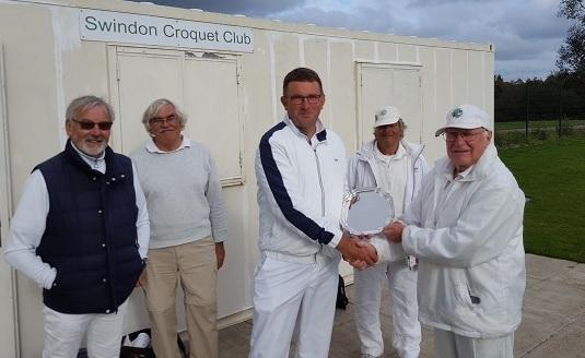 Swindon Croquet Club secretary John Airey presents the trophy to Andy Smith