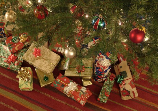 A Generic photo of Christmas presents under the tree.  See PA Feature CHRISTMAS Benefits. PA Photo Generic.