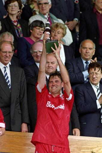 Swindon Town player Manager Glenn Hoddle celebrates with the Play Off Final trophy
