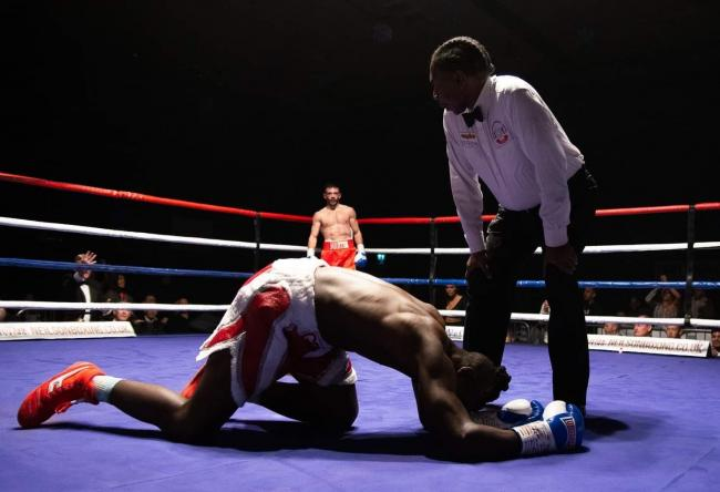 Ryan Martin looks on after sending Mziwoxolo Ndwayana to the canvas during Saturday night's bout at the Oasis Leisure Centre. PICTURE: NEILSON BOXING