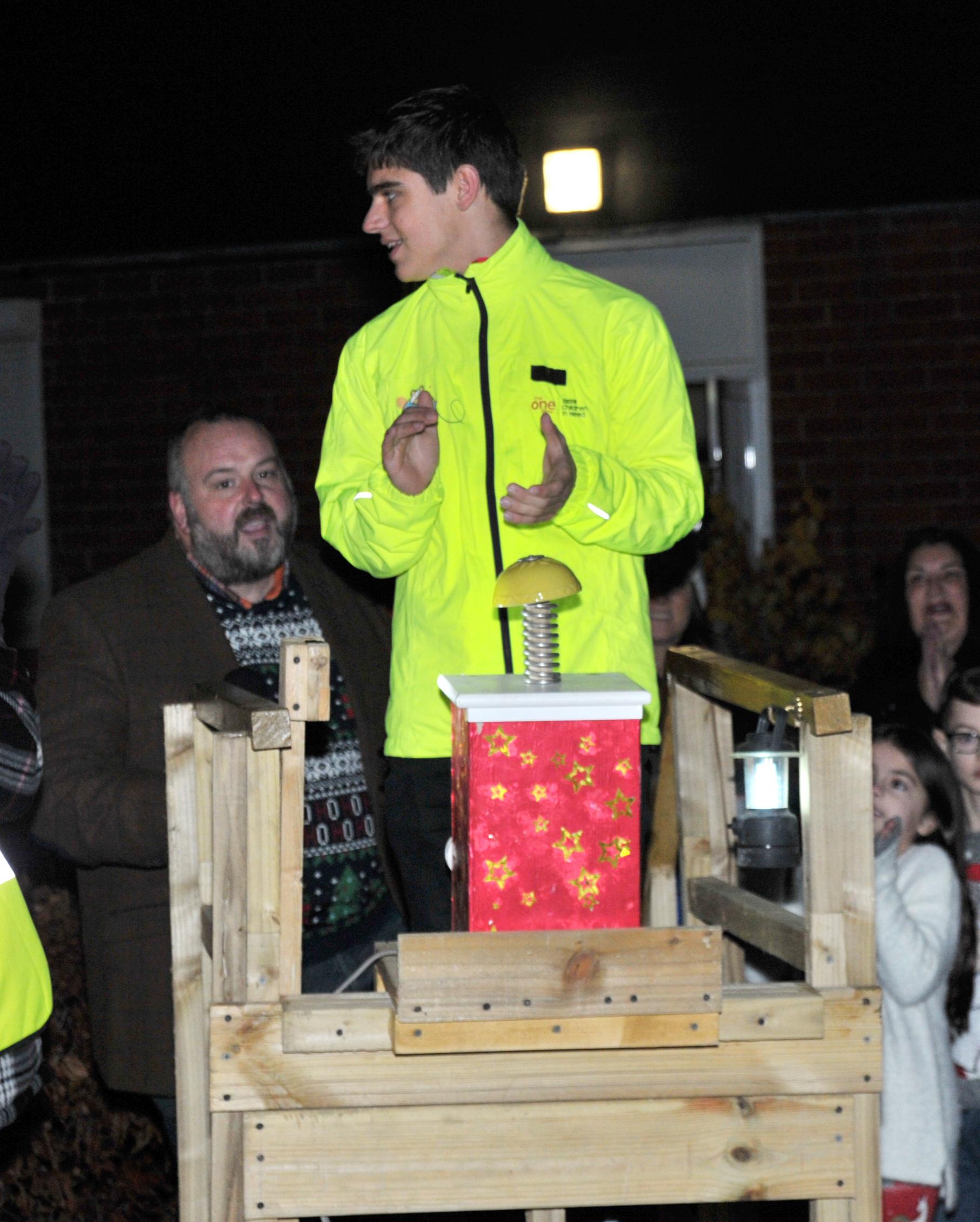 Children in Need Rickshaw rider Tom, 17, helps switch on Wroughton lights