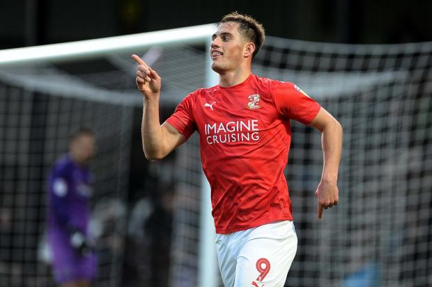 Swindon Town striker Jerry Yates celebrates the first of his two goals during Saturday's 3-0 win away at Grimsby Town in League Two	Picture: DAVE EVANS