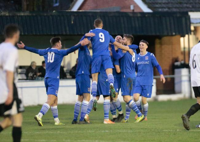 The Swindon Supermarine players celebrate as Alex Henshall puts them 2-0 up at Wimborne Town; PICTURE: JEFF YOUD