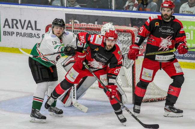 Swindon Wildcats (black) player-coach Aaron Nell (right) and fellow forward Tomasz Malasinski (centre) both scored twice in Saturday night's 8-4 win at home to Hull Pirates