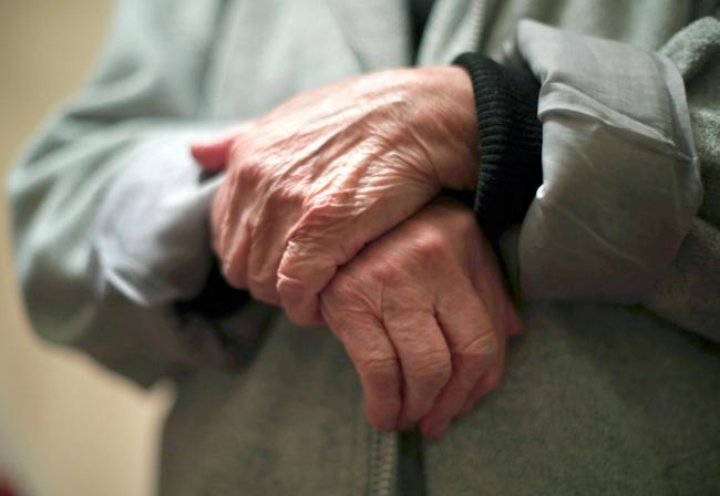 Embargoed to 0001 Thursday December 19 File photo dated 21/12/17 of the hands of an elderly woman. Nearly a third of people aged 80 and over collectively provide 23 million hours of unpaid care a week, according to new analysis by Age UK.