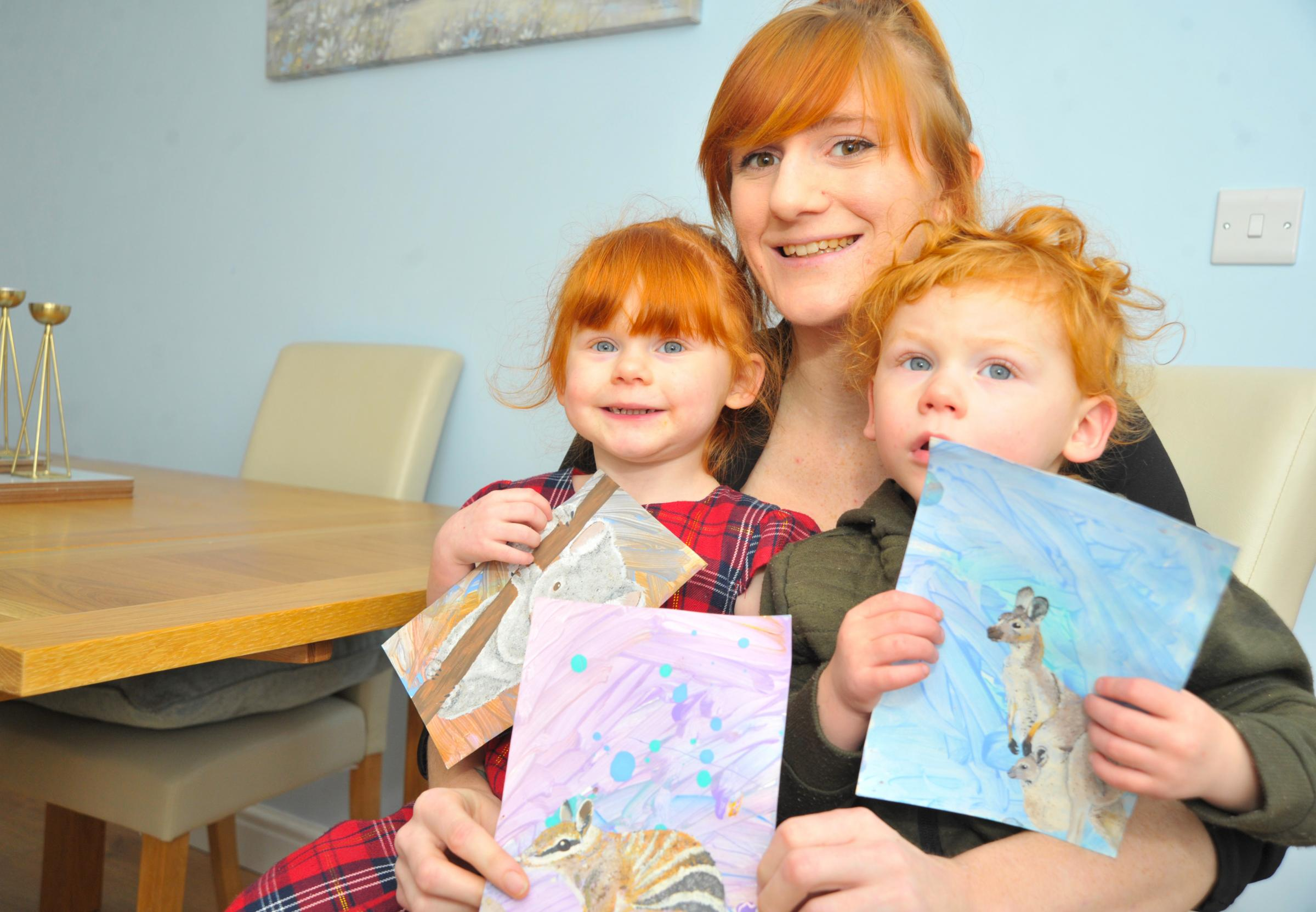 Family painting pictures to raise money for Australia's animals