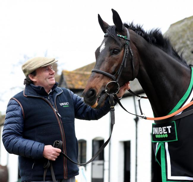 Trainer Nicky Henderson poses for a photo with Altior at Seven Barrows, Lambourn        Pic: PA