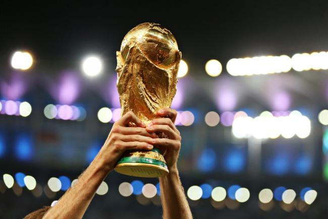 File photo dated 13-07-2014 of a player lifting the FIFA World Cup Trophy. PRESS ASSOCIATION Photo. Issue date: Wednesday May 30, 2018. Controversy, intrigue and apprehension are not normally the overriding emotions ahead of a World Cup. See PA story SOCC