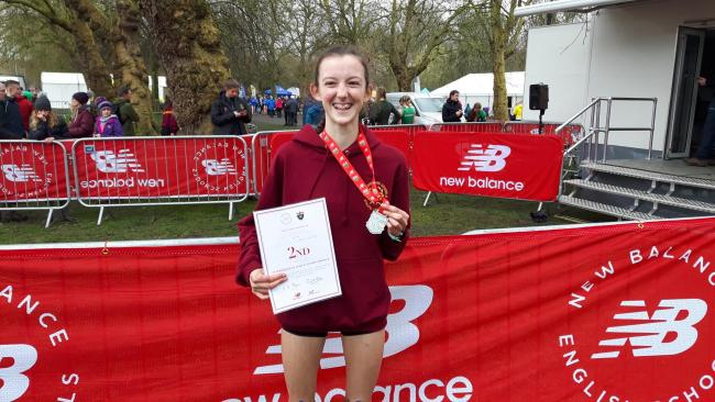 Highworth Running Club's Kiya Dee shows off her medal and certificate after finishing runner-up at the English Schools' Cross Country Championship in Liverpool last weekend