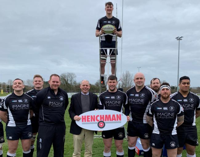 Henchman general manager Michael Byers with  Royal Wootton Bassett RFC head coach Alan Low and his squad