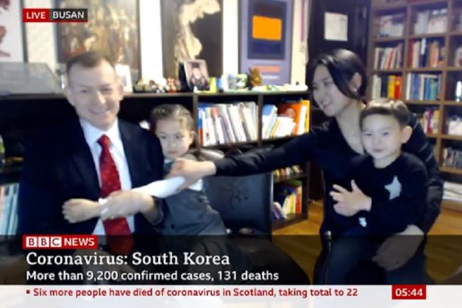 Professor Robert E Kelly and his family in a BBC World appearance live from Busan