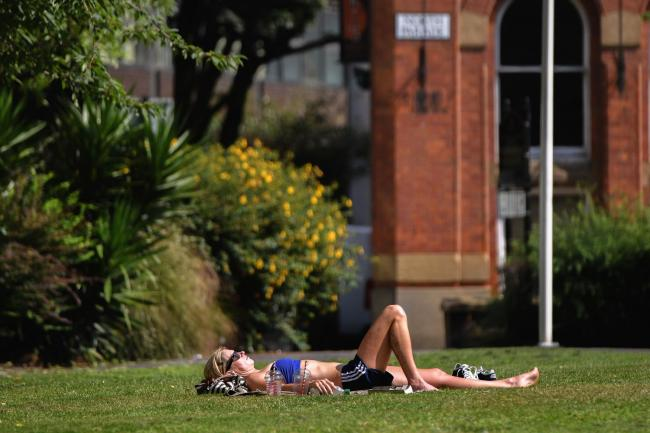 Sunbathing is banned under lockdown rules. Picture: PA