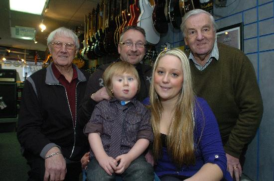 Morgan Sharpe and mum Kerry Holmes, with John Holmes, Alan Holmes and Roddy Marshall of the British Heart Foundation