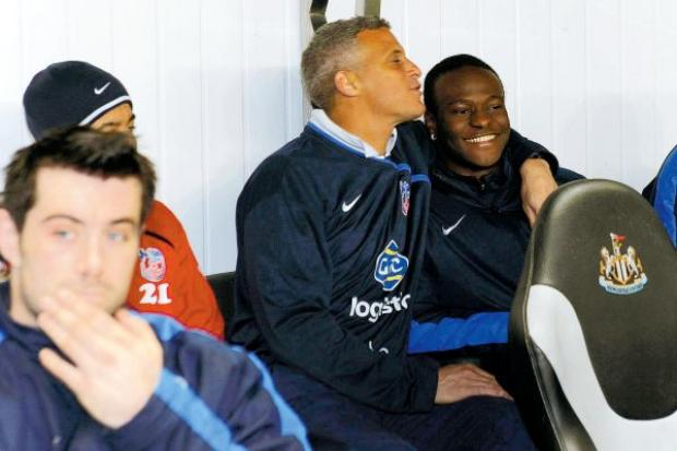 TOP TARGET: Victor Moses, pictured being hugged by Palace coach Keith Curle on the bench at St James' Park on Wednesday, is still wanted by Chris Hughton